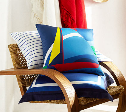 Nautical throw pillows with stripes & bright sailboat motif