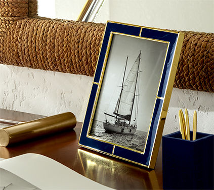 Navy & gold enamel picture frame on desk