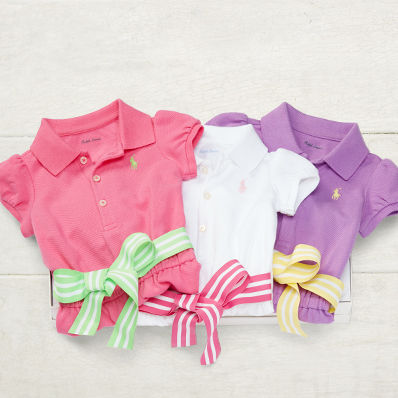 Set of three cap-sleeve Polo shirts with striped ribbons at the waist.