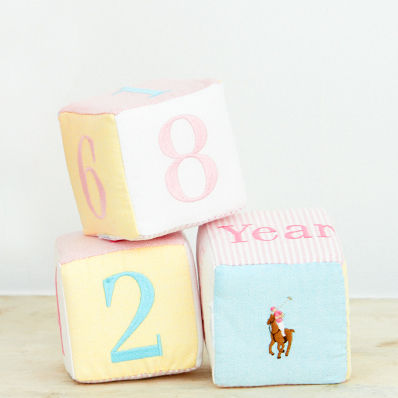 Set of plush cotton blocks with embroidered numbers.