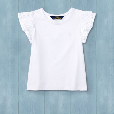 White T-shirt with embroidered eyelets at the cap sleeves.