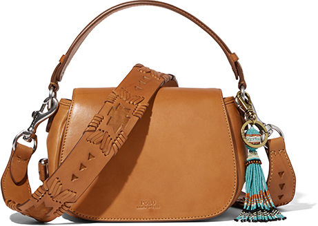 Tan leather saddle bag with colorful tassel.