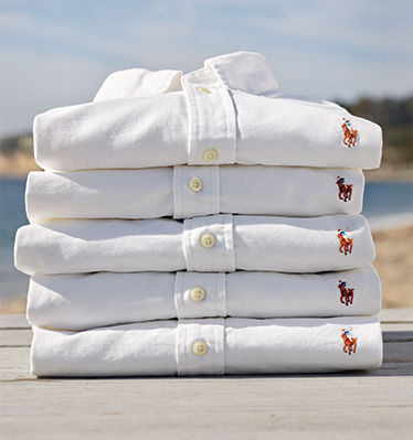 Stack of neatly folded button-downs with signature Polo Pony at chest