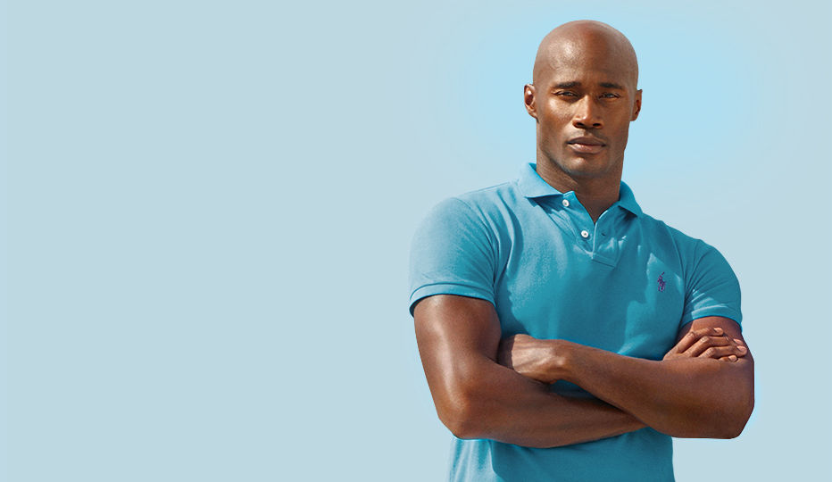 Man models bright blue Polo shirt