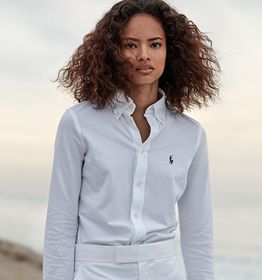 Woman models white oxford shirt with signature Polo Pony at chest