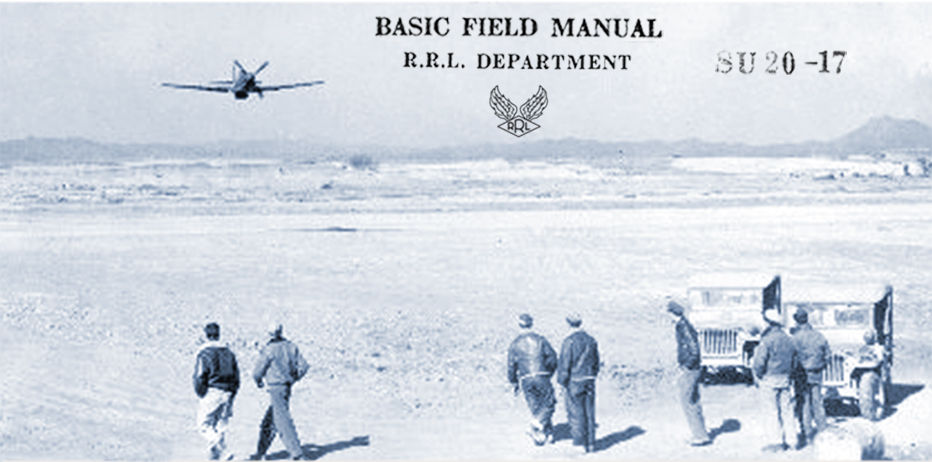 Basic Field Manual. R.R.L. Department. Men on field stand next to jeeps, watching approaching plane