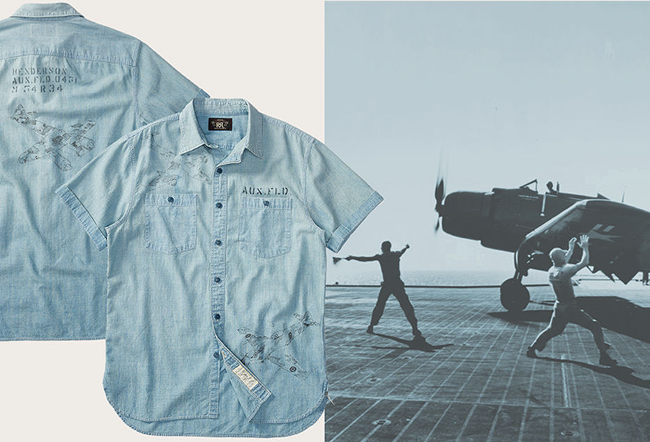 Faded, casual button-down with airplane stencil at back. Men directing propeller plane on landing strip