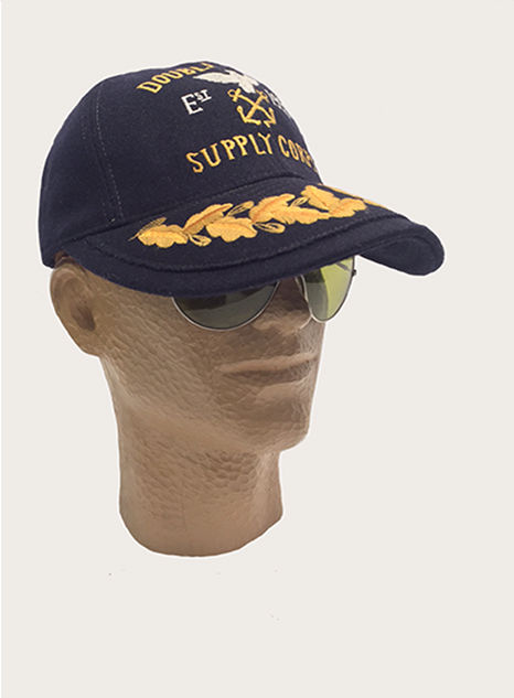 Cap with gold lettering at front & leaf motif at brim