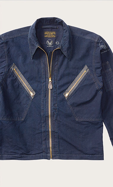 Navy shirt with full-zip front and slanted zip pockets at chest