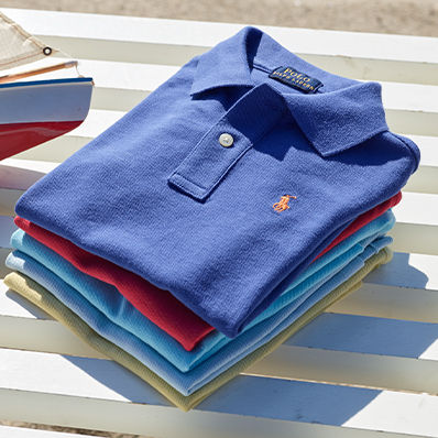 Stack of neatly folded Polo shirts in various colors.