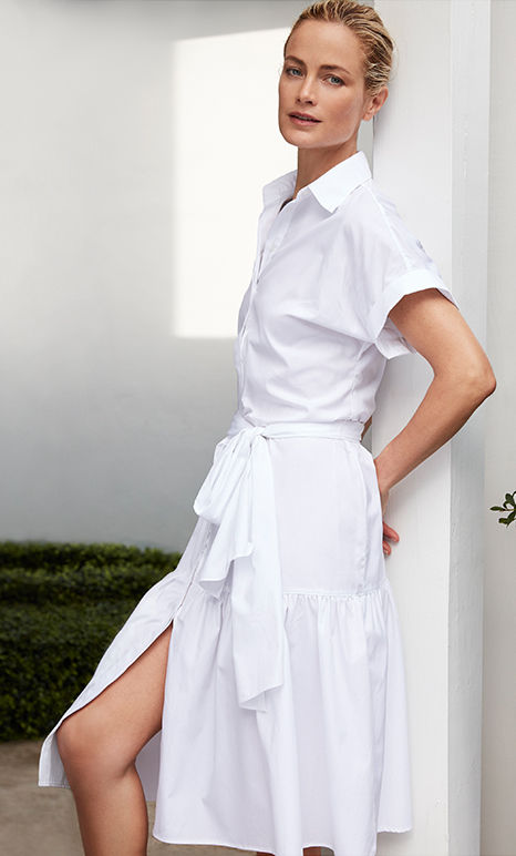 Woman models white short-sleeve shirtdress with tie-front