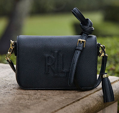Black leather crossbody with tassel accent