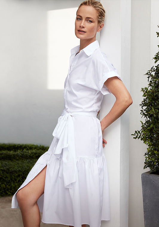 Woman models lightweight short-sleeve shirtdress with tie-front