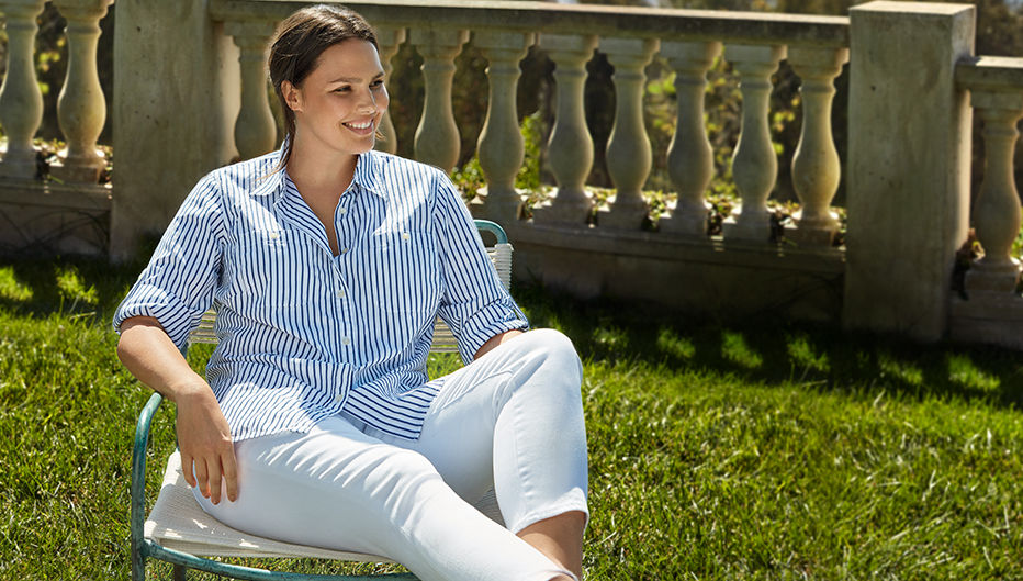 Woman models blue-and-white striped shirt and white cropped pants