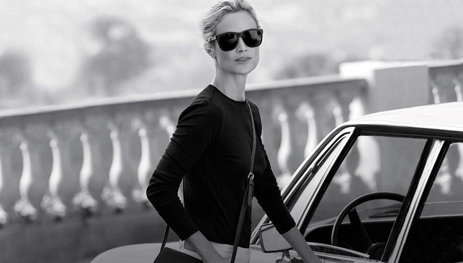 Carolyn Murphy in shades & button-shoulder top, getting into car