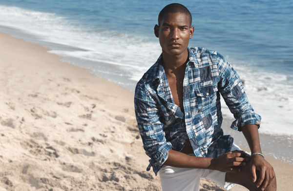 Man models button-down with patchwork construction in shades of blue