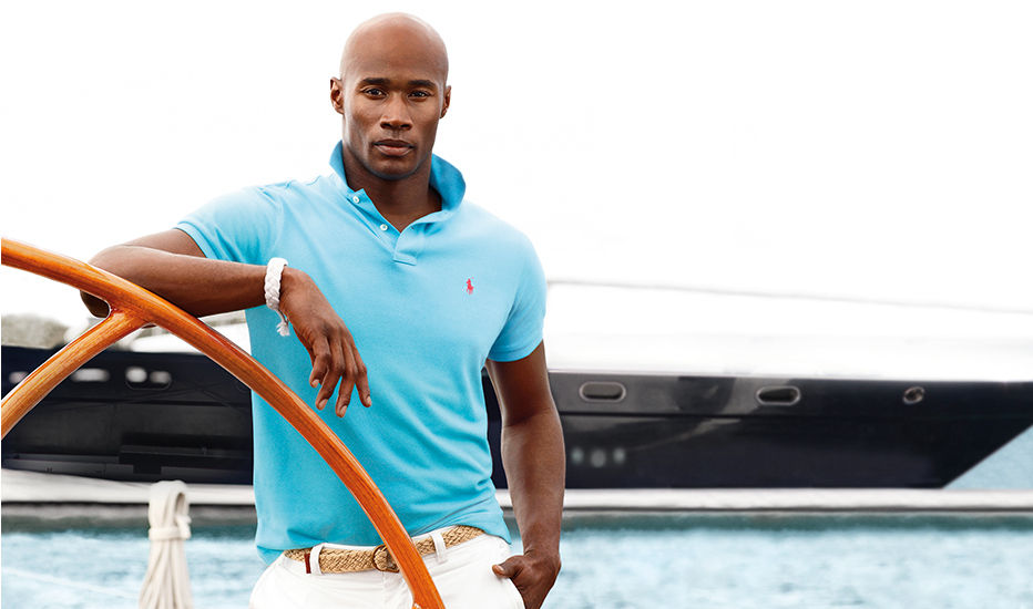 Man models aqua Polo shirt with yellow embroidered Polo Pony at chest