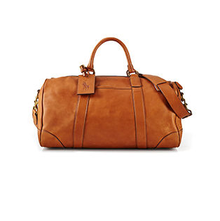 Tan leather duffel bag with Polo Pony luggage tag