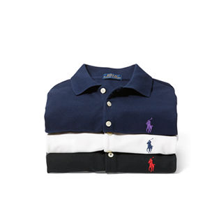 Stack of folded black, white & navy Polo shirts