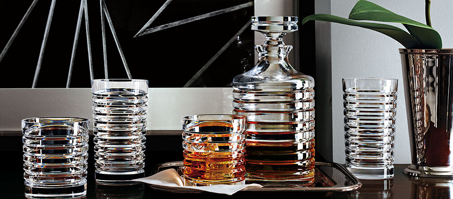 Hand-cut crystal glasses and decanter featuring beveled, engine-turned grooves