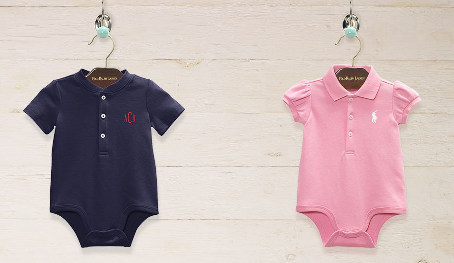 Personalized short-sleeve Polo bodysuits in blue and pink displayed on hangers.