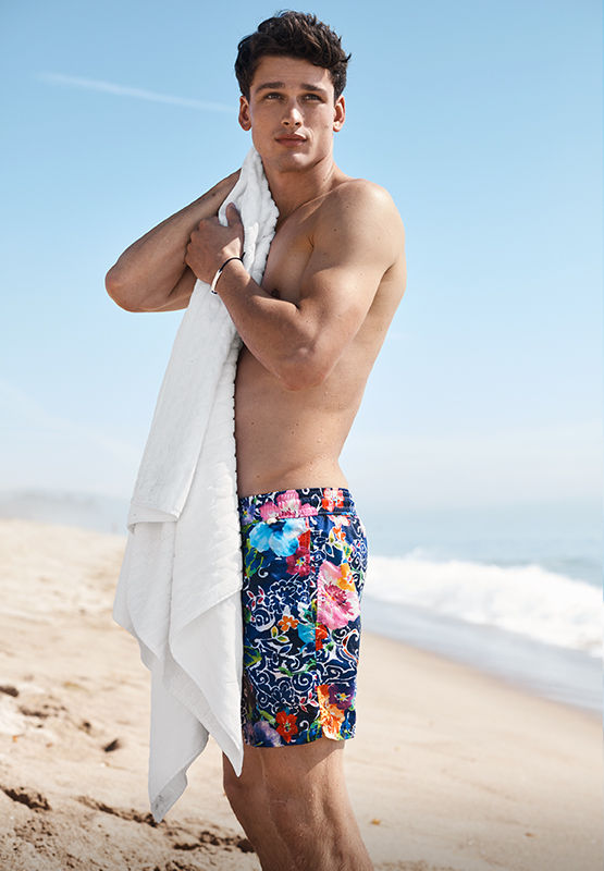 Man in vibrant floral-print swim trunks