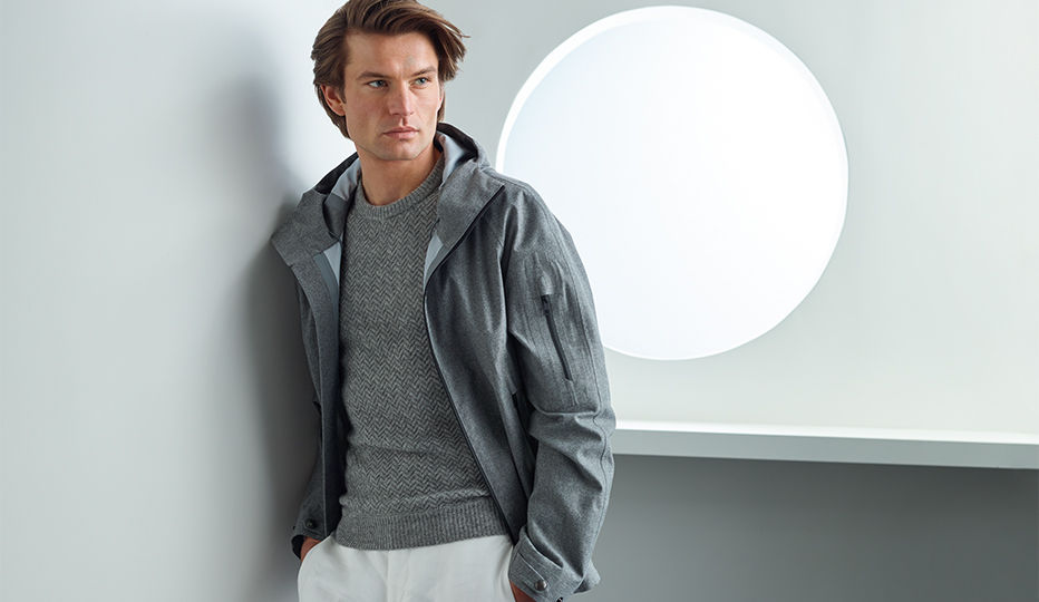 Man models grey performance jacket
