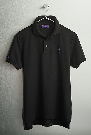 Black Polo shirt with purple signature embroidered pony at chest