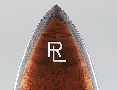 Top half of surfboard accented with RL logo