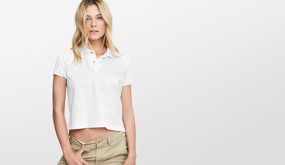 Woman models white cropped Polo shirt