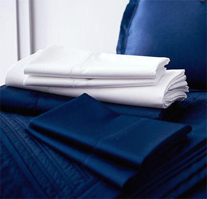 Folded navy & white sheets