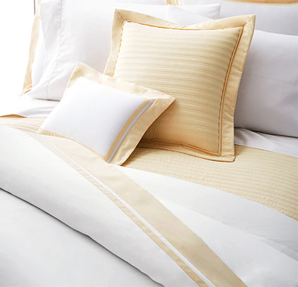 White duvet cover with natural-hued stripes at border
