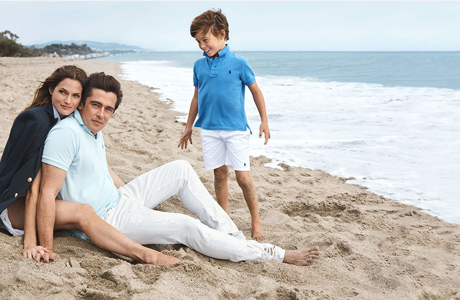 Mom in blazer and Dad and son in Polo shirts on beach