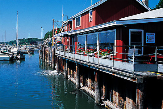 Red paneled restaurant on dock by water