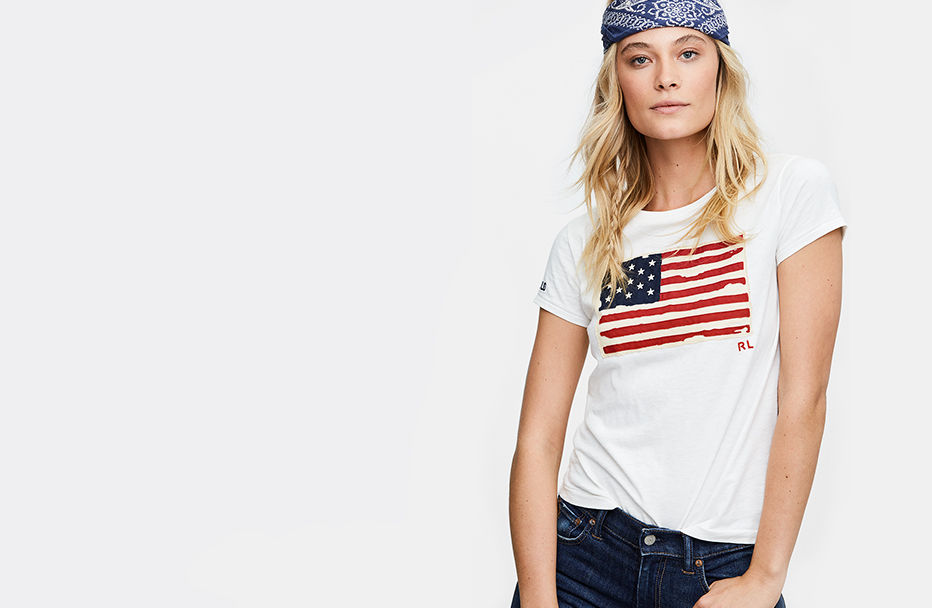 Woman in white tee with American flag appliqué at front
