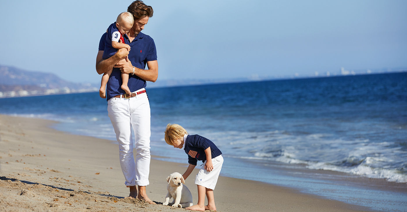 Man with two kids on beach in Americana-inspired Polo apparel