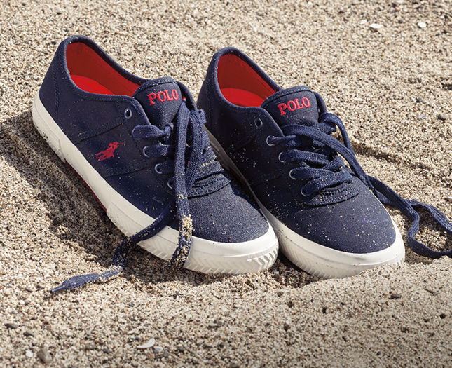 Navy sneakers with red Polo Pony at sides