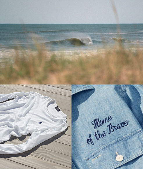 White sweatshirt on dock by beach & 'Home of the Brave'-embroidered shirt