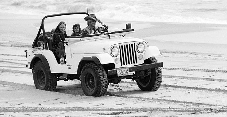Ralph Lauren & family in jeep on East Hampton beach in 1977