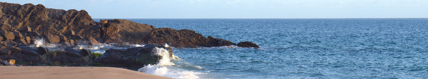 Scenic image of rocks extending into ocean