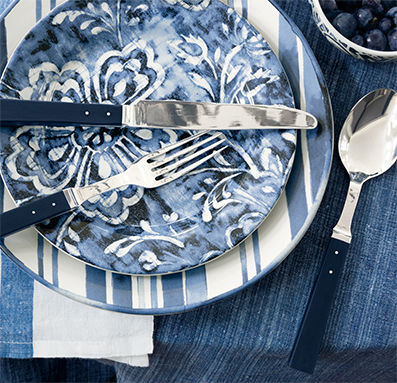 Dinner plates with stripes & floral designs in shades of blue