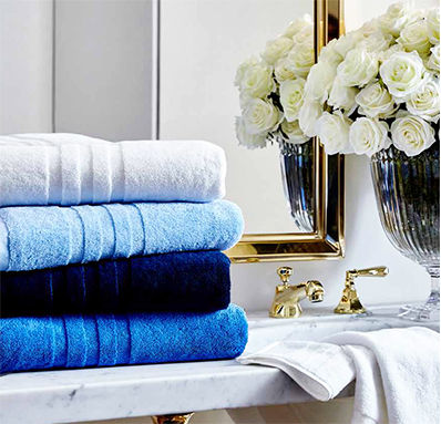 Stack of folded towels in shades of blue