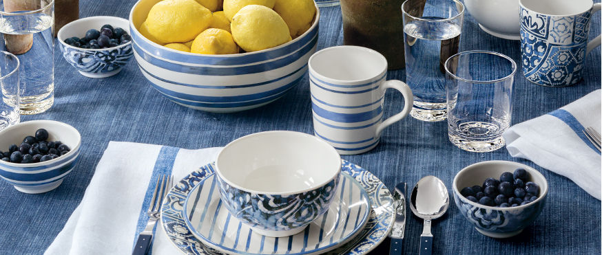 Table setting with floral & striped designs in shades of blue