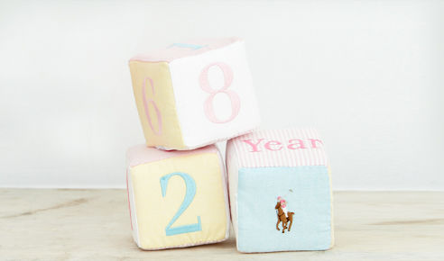 Set of three cotton embroidered age blocks.