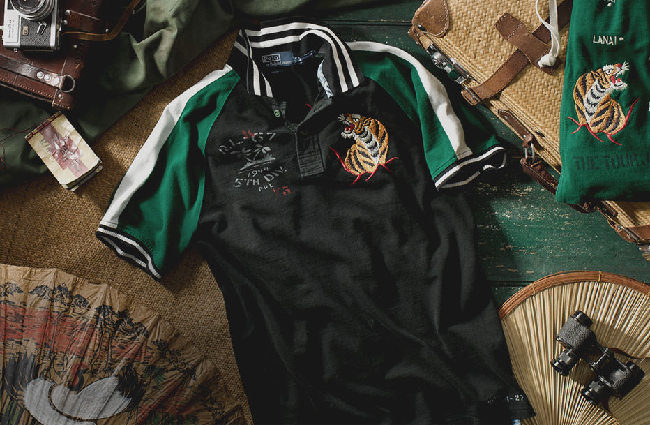 Polo shirt with intricately embroidered tiger motif & striped armbands & collar