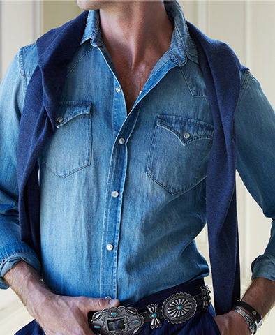 Man modeling denim western shirt & concho-plaque belt
