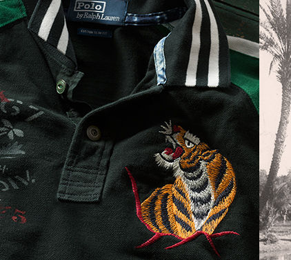Close-up image of embroidered tiger & striped collar