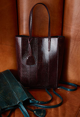 Textured leather totes in dark green and garnet