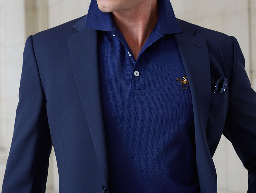 Close-up of man wearing royal blue Polo shirt under navy blazer