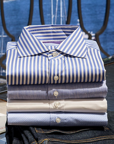 Stack of neatly folded button-downs in stripes & light hues